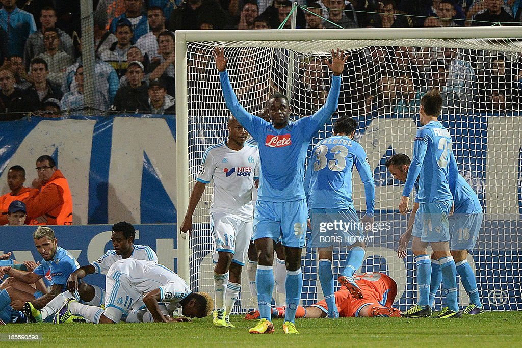 Napoli's Colombian forward Zapata Duvan Esteban (C) celebrates on October 22, 2013 after a UEFA Champion's league Group F football match against Marseille at the Velodrome stadium in the southern French city of Marseille.