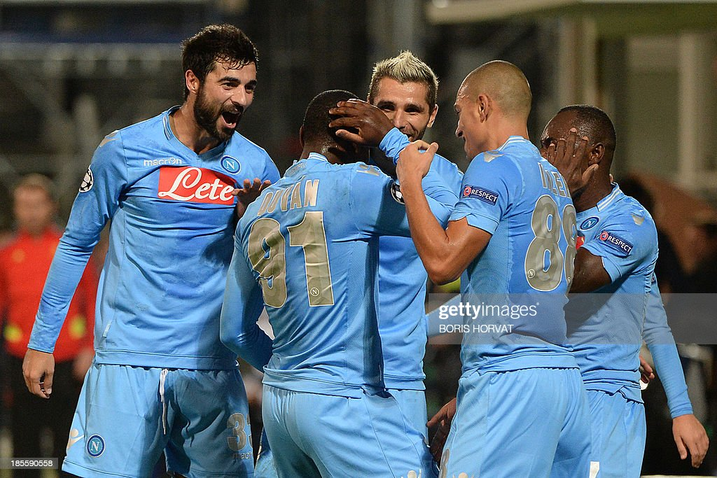 Napoli's Colombian forward Zapata Duvan Esteban (2nd L) celebrates with teammates after scoring against Marseille on October 22, 2013 during a UEFA Champion's league Group F football match at the Velodrome stadium in the southern French city of Marseille.