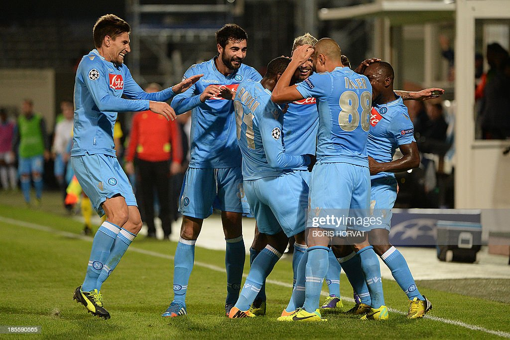 Napoli's Colombian forward Zapata Duvan Esteban (C) celebrates with teammates after scoring against Marseille on October 22, 2013 during a UEFA Champion's league Group F football match at the Velodrome stadium in the southern French city of Marseille.