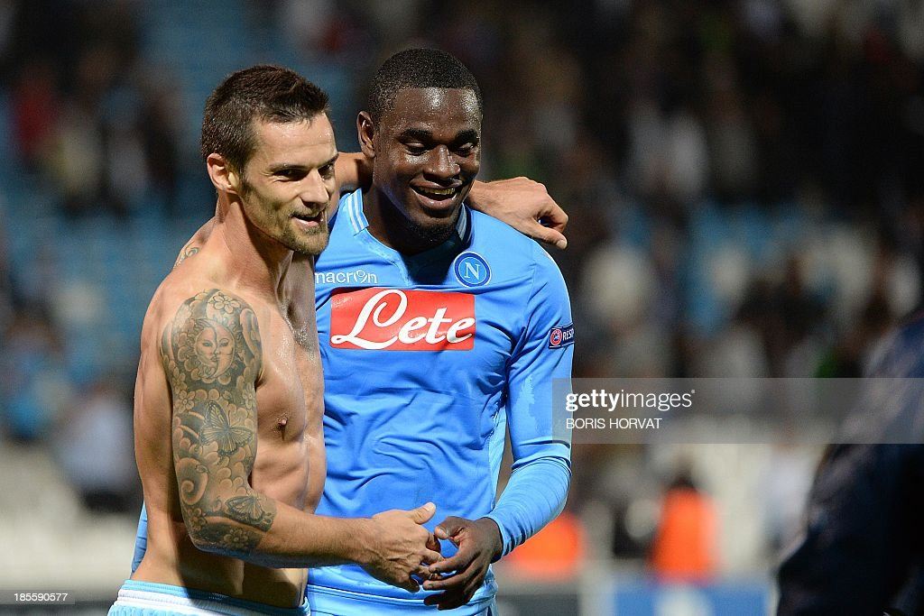 Napoli's Colombian forward Zapata Duvan Esteban (R) celebrates with Napoli midfielder Christian Maggio (L) on October 22, 2013 after a UEFA Champion's league Group F football match against Marseille at the Velodrome stadium in the southern French city of Marseille.