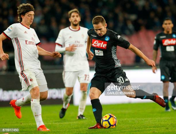 Napoli's Croatian midfielder Marko Rog kicks the ball next to Milan's Italian midfielder Riccardo Montolivo during the Italian Serie A football match...