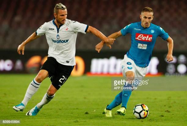 Napoli's Croatian midfielder Marko Rog runs for the ball against Atalanta'a Slovenian midfielder Jasmin Kurtic during the Italian Serie A football...