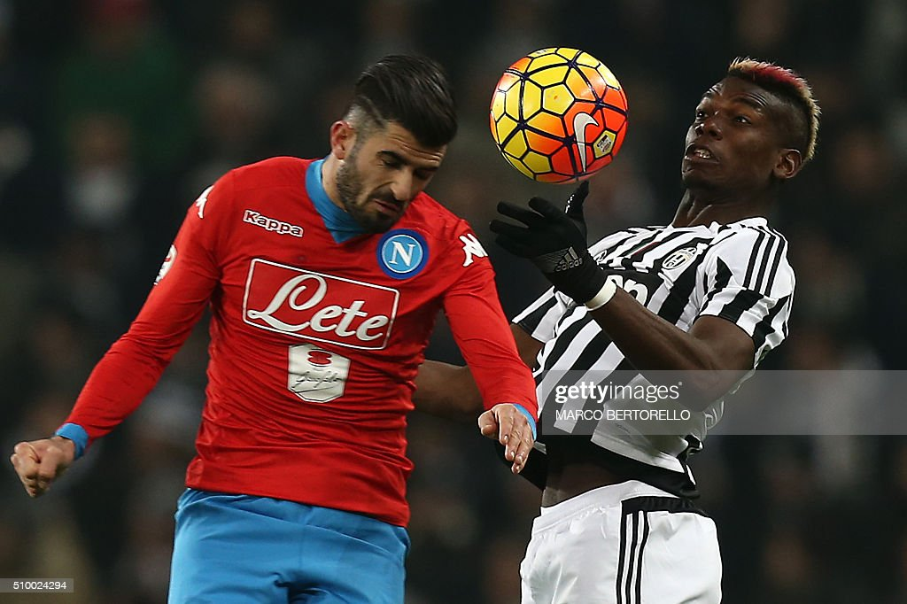 Napoli's defender Elseid Hysaj from Albania (L) fights for the ball with Juventus' midfielder Paul Pogba from France during the Italian Serie A football match Juventus Vs Napoli on February 13, 2016 at the 'Juventus Stadium' in Turin. / AFP / MARCO BERTORELLO