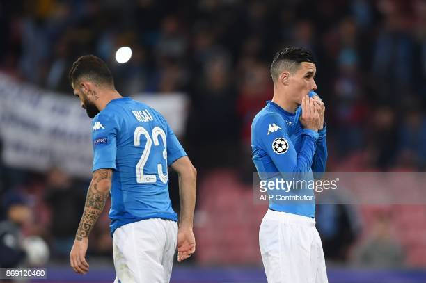 Napoli's defender from Albania Elseid Hysaj and Napoli's midfielder from Spain Jose Maria Callejon react at the end of the UEFA Champions League...