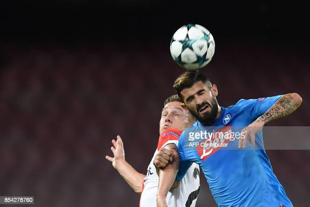 Napoli's defender from Albania Elseid Hysaj fights for the ball with Feyenoord's Dutch midfielder Jens Toornstra during the UEFA Champion's League...