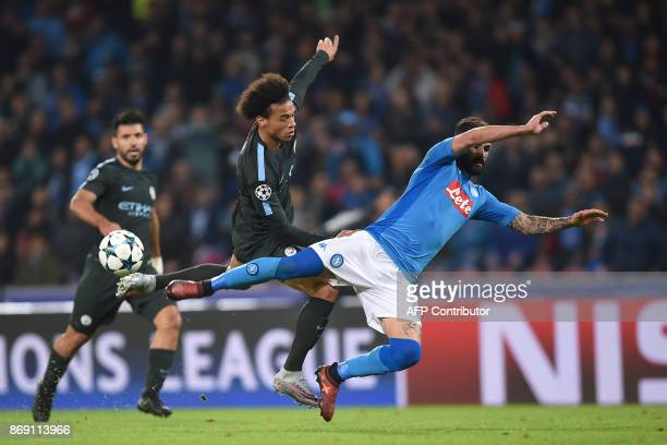 Napoli's defender from Albania Elseid Hysaj fights for the ball with Manchester City's German midfielder Leroy Sane during the UEFA Champions League...