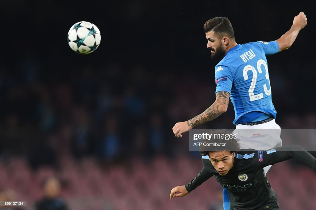 Napoli's defender from Albania Elseid Hysaj (R) fights for the ball with Manchester City's German midfielder Leroy Sane during the UEFA Champions League football match Napoli vs Manchester City on November 1, 2017 at the San Paolo stadium in Naples. Manchester City won 2-4. / AFP PHOTO / Filippo MONTEFORTE