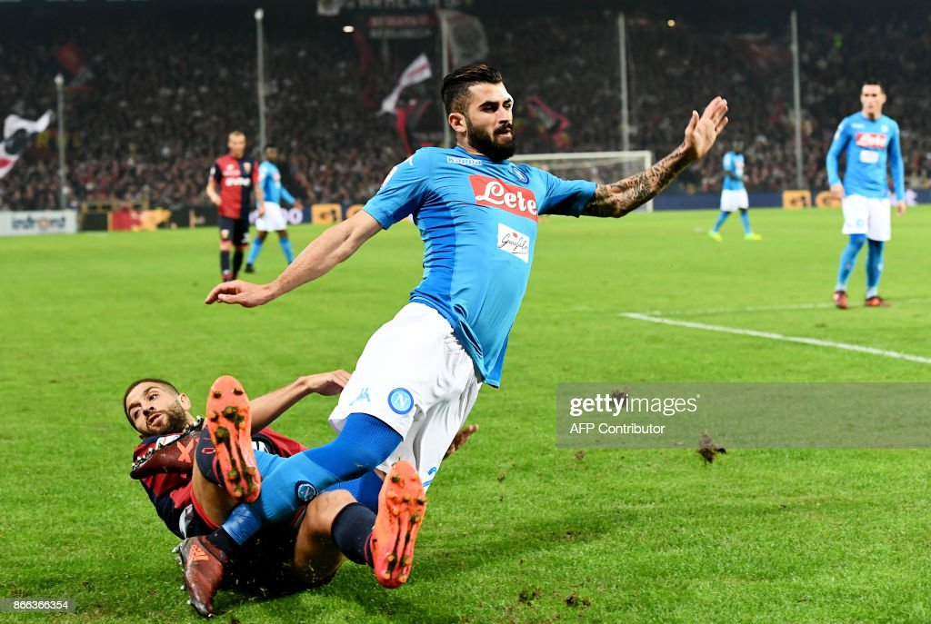 Napoli's defender from Albania Elseid Hysaj (R) is tackled by Genoa's midfielder from Albania Adel Taarab during the Italian Serie A football match Genoa vs Napoli on October 25, 2017 at the Ferraris stadium in Genova. / AFP PHOTO / Vincenzo PINTO