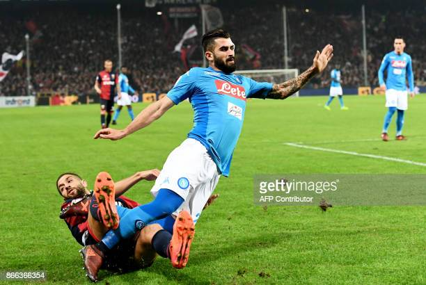 Napoli's defender from Albania Elseid Hysaj is tackled by Genoa's midfielder from Albania Adel Taarab during the Italian Serie A football match Genoa...