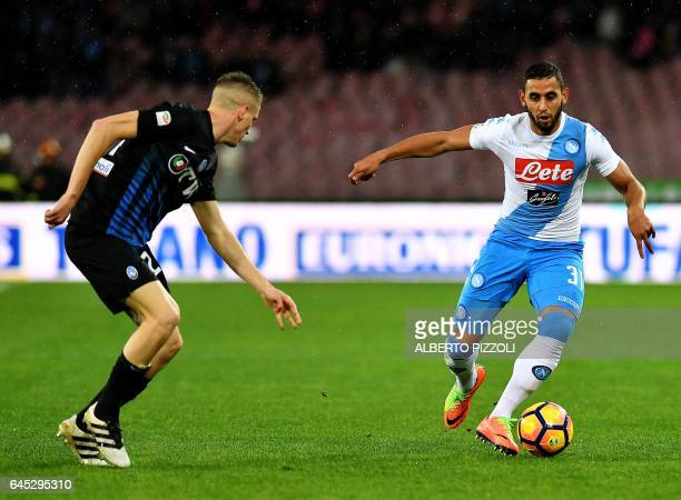 Napoli's defender from Algeria Faouzi Ghoulam fights for the ball with Atalanta's defender Andrea Conti during the Italian Serie A football match...