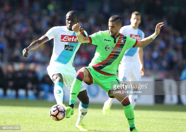 Napoli's defender from France Kalidou Koulibaly fights for the ball with Crotone's Italian forward Diego Falcinelli during the Italian Serie A...
