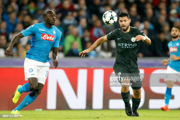 Napoli's defender from France Kalidou Koulibaly vies with Manchester City's Argentinian striker Sergio Aguero during the UEFA Champions League...