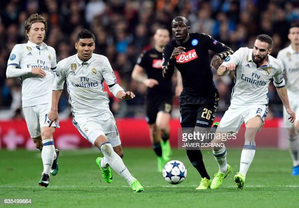 Napoli's defender from France Kalidou Koulibaly vies with Real Madrid's Croatian midfielder Luka Modric Real Madrid's Brazilian midfielder Casemiro...