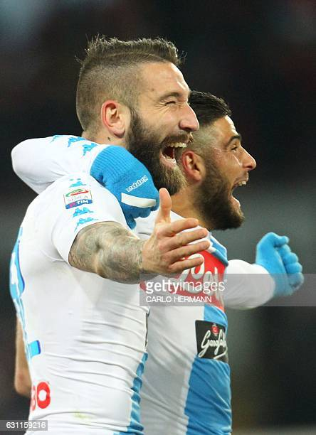 Napoli's defender from Italy Lorenzo Tonelli celebrates with teammate Napoli's forward from Italy Lorenzo Insigne after scoring a goal at the last...