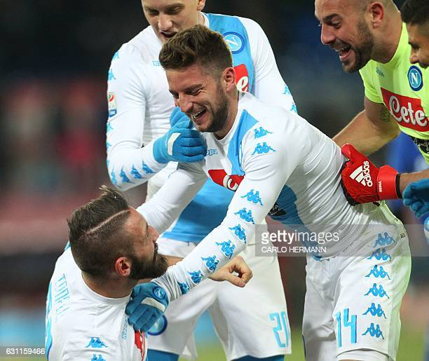 Napoli's defender from Italy Lorenzo Tonelli celebrates with teammates after scoring at the last minute during the Italian Serie A football match SSC...