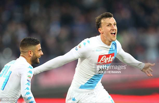 Napoli's defender from Romania Vlad Chiriches celebrates after scoring near Napoli's forward from Italy Lorenzo Insigne during the Italian Serie A...