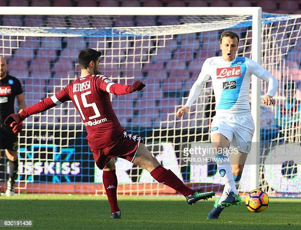 Napoli's defender from Romania Vlad Chiriches vies with Torino's midfielder from Italy Marco Benassi during the Italian Serie A football match SSC...