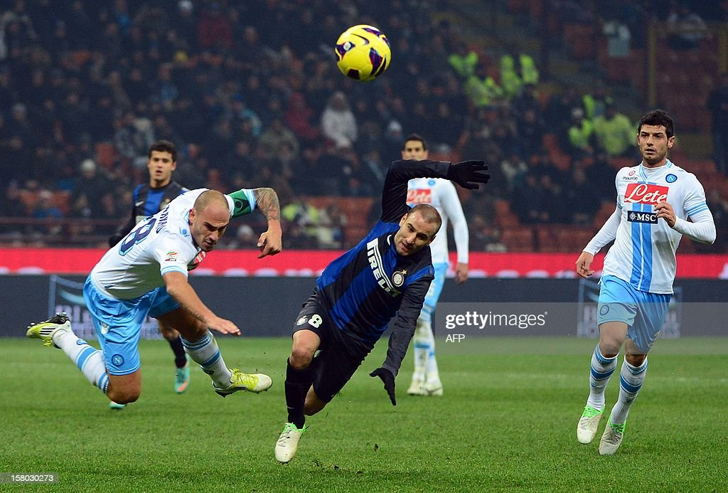 Napoli's defender Paolo Cannavaro (L) fights for the ball with Inter Milan's Argentinian forward Rodrigo Sebastian Palacio during the Italian serie A football match between Inter MIlan and Napoli on December 9, 2012 at the San Siro stadium in Milan. AFP PHOTO / OLIVIER MORIN