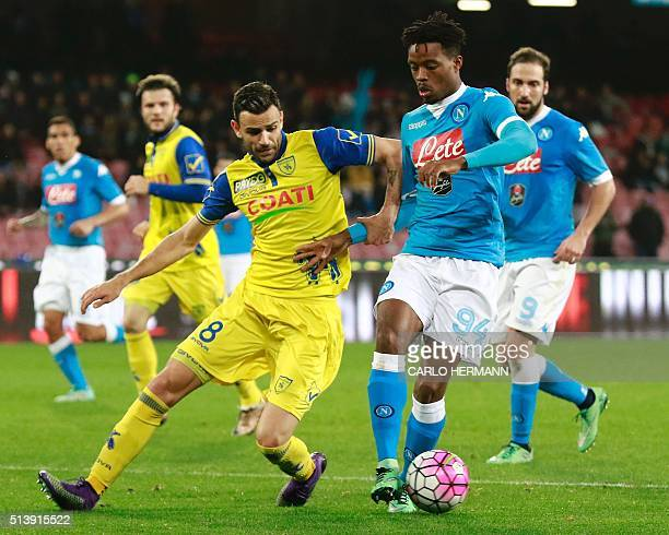 Napoli's English midfielder Nathaniel Chalobah fights for the ball with Chievo's Serbian midfielder Ivan Radovanovic during the Italian Serie A...