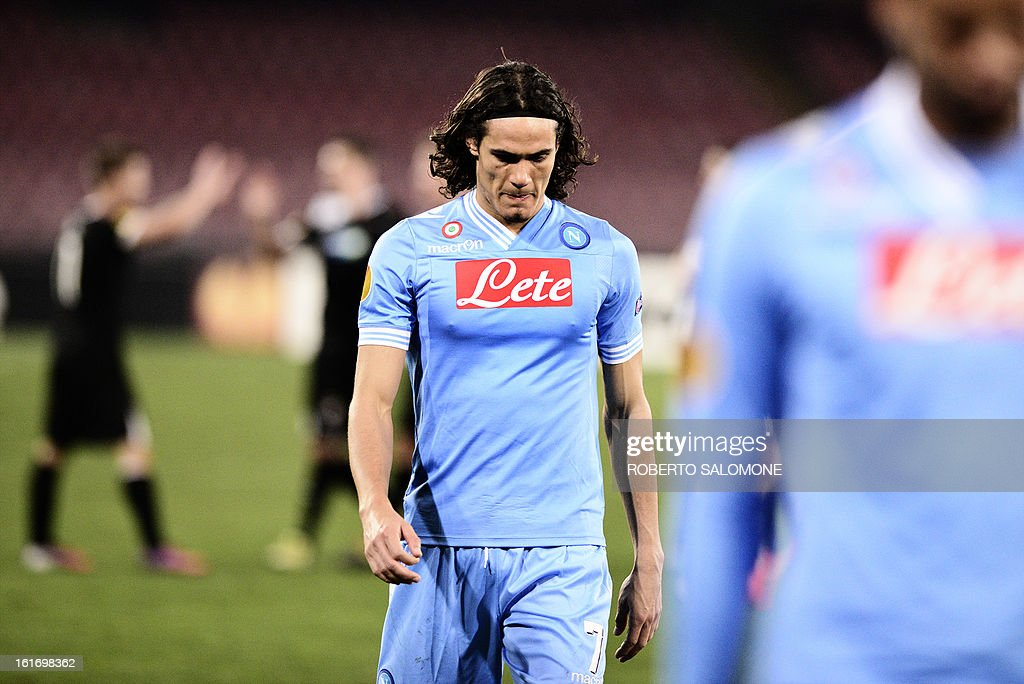 SSC Napoli's forward Edinson Cavani walks off the field at the end of the UEFA Europa League football match SSC Napoli vs Victoria Plzen at San Paolo Stadium in Naples on February 14, 2013.