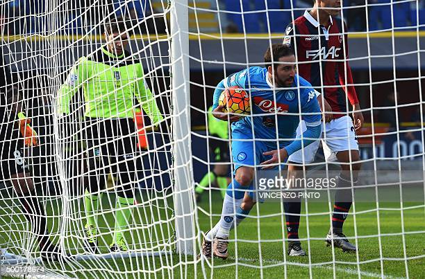 Napoli's forward from Argentina Gonzalo Higuain celebrates after scoring during the Italian Serie A football match Bologna vs Napoli at the Dall'Ara...