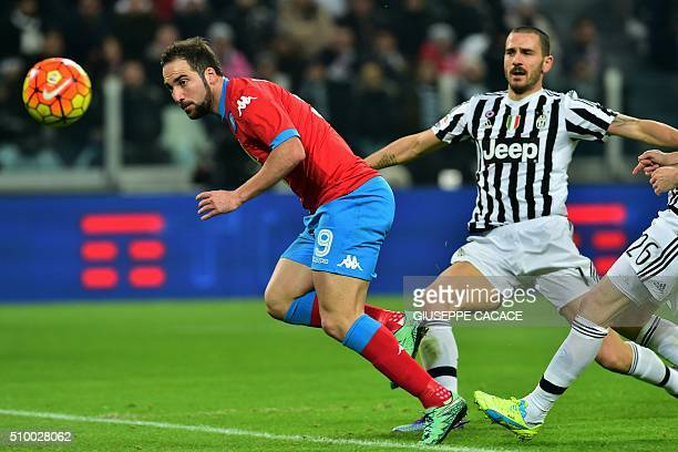 Napoli's forward from Argentina Gonzalo Higuain eyes the ball flanked by Juventus' defender from Italy Leonardo Bonucci during the Italian Serie A...