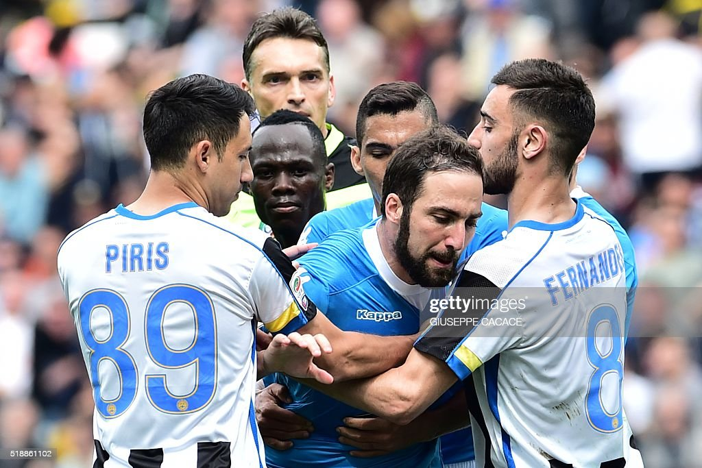 Napoli's forward from Argentina Gonzalo Higuain reacts after he received a red card during the Italian Serie A football match Udinese vs Napoli at Friuli Stadium in Udine on April 3, 2016. / AFP / GIUSEPPE