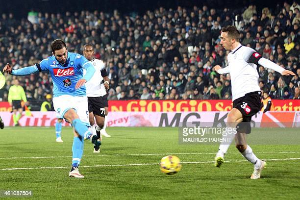 Napoli's forward from Argentina Gonzalo Higuain scores during the Italian Serie A football match Cesena vs Napoli at the 'Dino Manuzzi' stadium in...