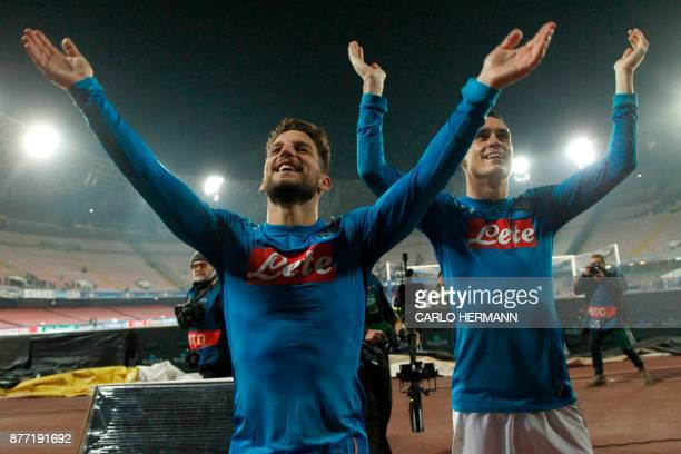 Napoli's forward from Belgium Dries Mertens and Napoli's midfielder from Spain Jose Maria Callejon celebrate with fans after winning 30 the UEFA...