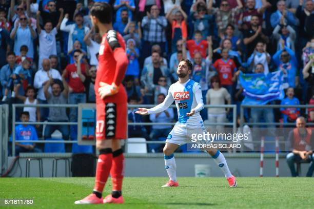Napoli's forward from Belgium Dries Mertens celebrates after scoring during the Italian Serie A football match Sassuolo vs Napoli on April 23 2017 at...