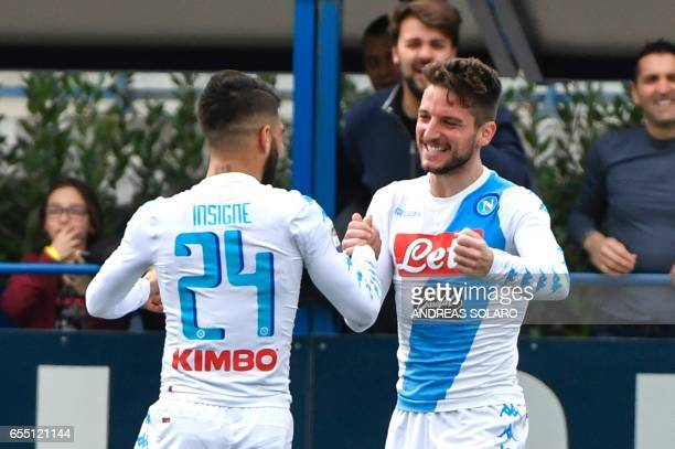 Napoli's forward from Belgium Dries Mertens celebrates with his team mate Insigne after scoring against Empoli during the Italian Serie A football...