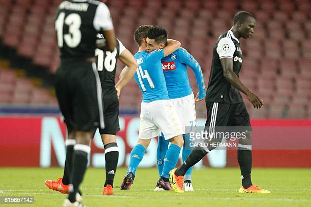 Napoli's forward from Belgium Dries Mertens celebrates with teammate Napoli's midfielder from Spain Jose Maria Callejon after scoring during the UEFA...