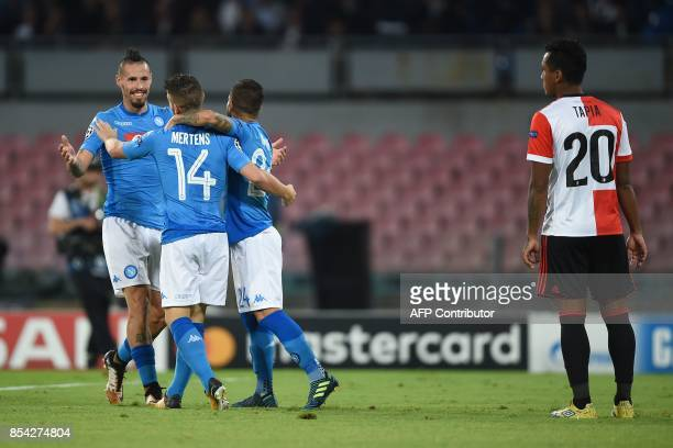 Napoli's forward from Belgium Dries Mertens celebrates with teammates Napoli's midfielder from Slovakia Marek Hamsik and Napoli's midfielder from...