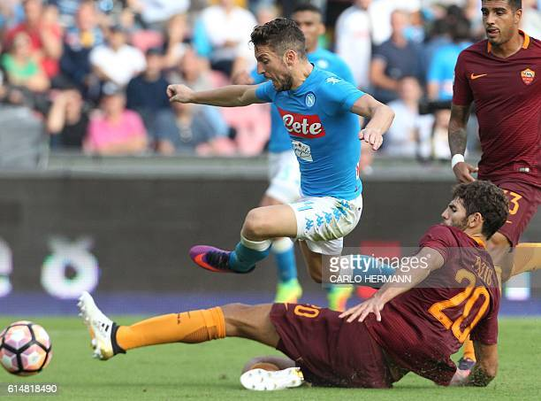 Napoli's forward from Belgium Dries Mertens fights for the ball with Roma's defender from Argentina Federico Fazio during the Italian Serie A...