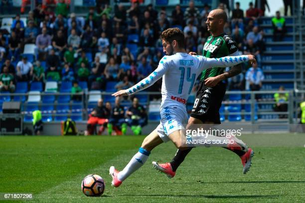 Napoli's forward from Belgium Dries Mertens fights for the ball with Sassuolo's defender from Italy Paolo Cannavaro during the Italian Serie A...