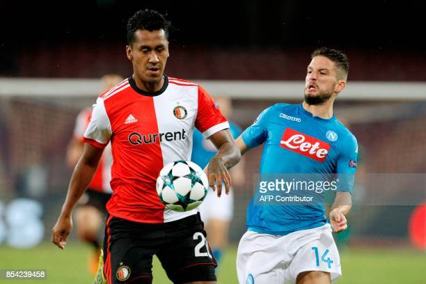 Napoli's forward from Belgium Dries Mertens fights for the ball with Feyenoord's Peruvian midfielder Renato Tapia during the UEFA Champion's League...