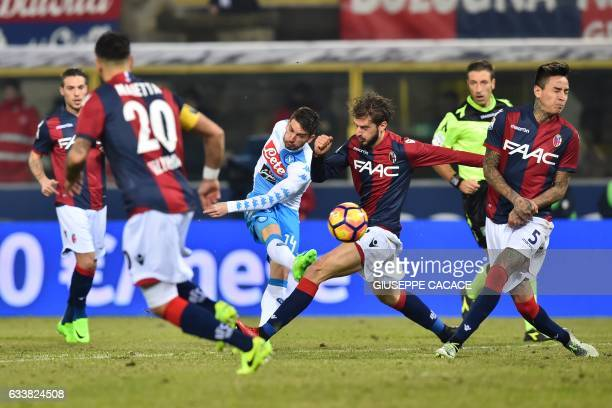 TOPSHOT Napoli's forward from Belgium Dries Mertens kicks the ball during the Italian Serie A football match Bologna vs Napoli at 'Renato Dall'Ara...