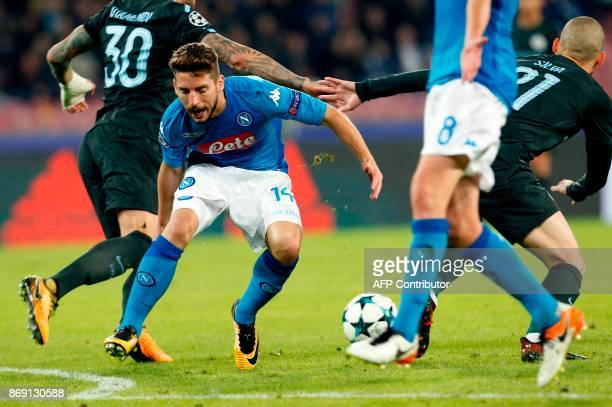 Napoli's forward from Belgium Dries Mertens reacts during the UEFA Champions League football match Napoli vs Manchester City on November 1 2017 at...