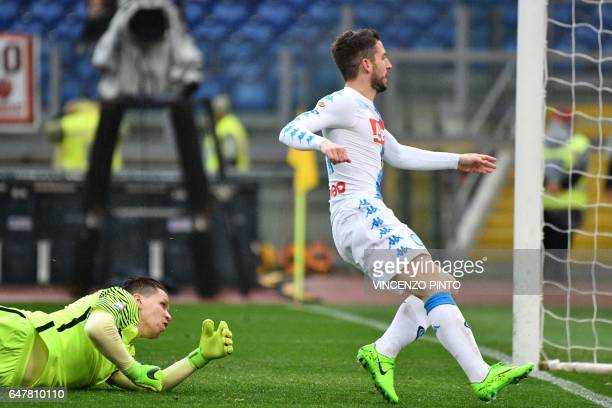 Napoli's forward from Belgium Dries Mertens scores against Roma's goalkeeper from Poland Wojciech Szczsny during the Italian Serie A football match...