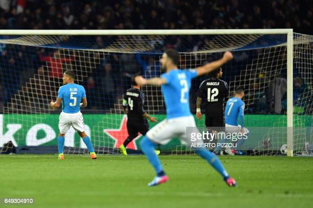 Napoli's forward from Belgium Dries Mertens scores during the UEFA Champions League football match SSC Napoli vs Real Madrid on March 7 2017 at the...