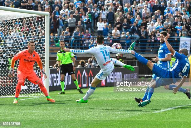 Napoli's forward from Belgium Dries Mertens shoots the ball against Empoli's defender from Italy Giuseppe Bellusci during the Italian Serie A...
