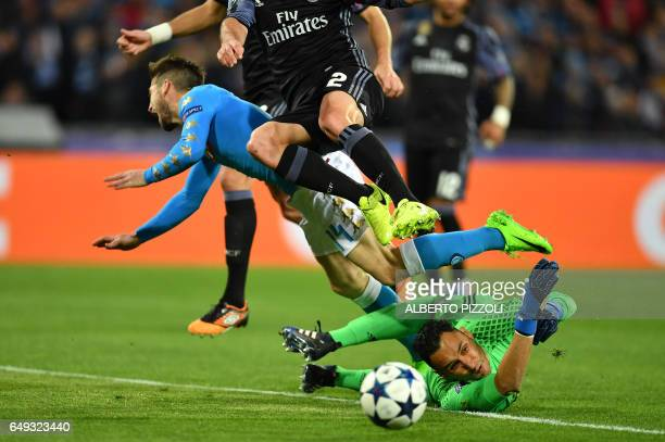 TOPSHOT Napoli's forward from Belgium Dries Mertens tries to score against Real Madrid's defender Dani Carvajal and Real Madrid's Costa Rican...