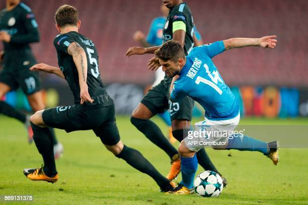 Napoli's forward from Belgium Dries Mertens vies with Manchester City's English defender John Stones during the UEFA Champions League football match...