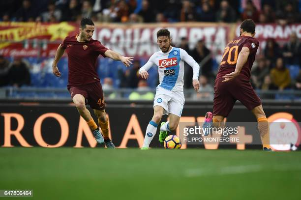 Napoli's forward from Belgium Dries Mertens vies with Roma's defender from Greece Kostas Manolas and Roma's defender from Argentina Federico Fazio...
