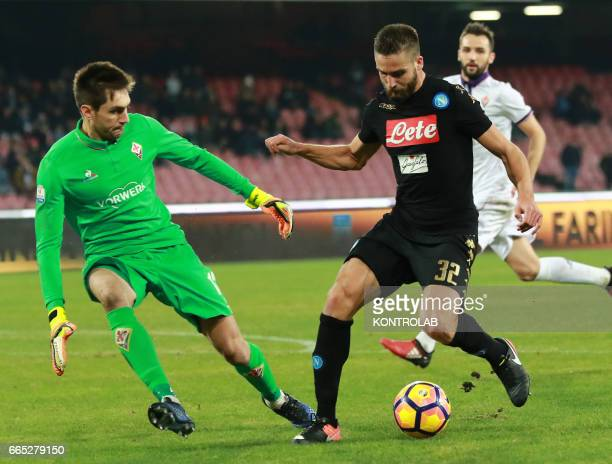 Napoli's forward from Italy Leonardo Pavoletti fights for the ball with Fiorentina's goalkeeper from Romania Ciprian Tatarusanu during the Italian...