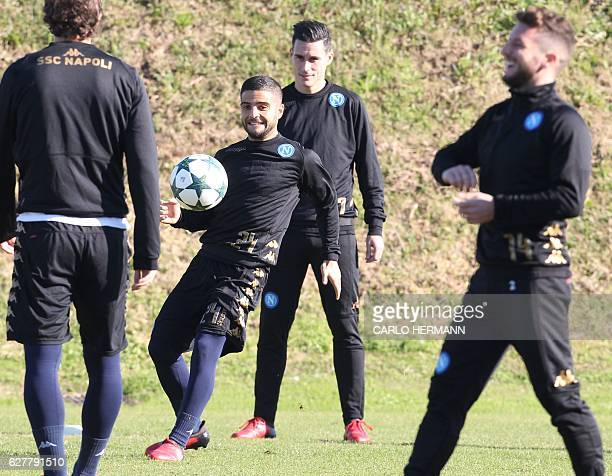 Napoli's forward from Italy Lorenzo Insigne controls the ball near teammate forward from Spain Jose Maria Callejon during a training session on the...