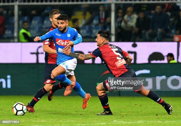 Napoli's forward from Italy Lorenzo Insigne vies with Genoa's defender from Italy Armando Izzo during the Italian Serie A football match Genoa vs...