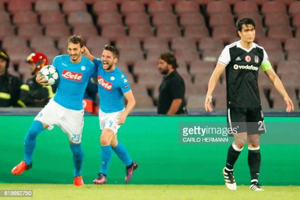 CORRECTION Napoli's forward from Italy Manolo Gabbiadini celebrates with Napoli's forward from Belgium Dries Mertens after scoring a penalty during...