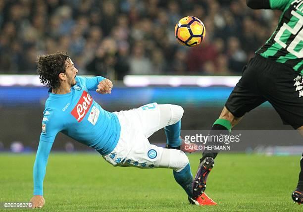 Napoli's forward from Italy Manolo Gabbiadini kicks the ball during the Italian Serie A football match SSC Napoli vs US Sassuolo Calcio on November...