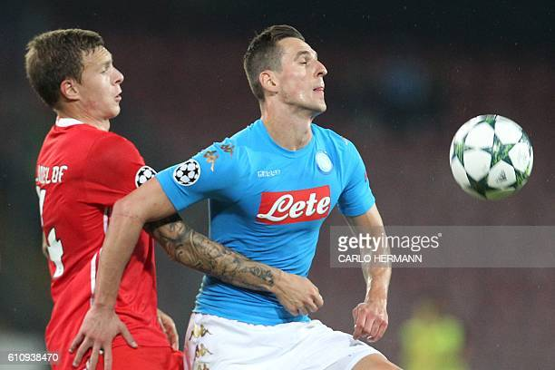 Napoli's forward from Poland Arkadiusz Milik fights for the ball with Benfica's Swedish defender Victor NilssonLindelof during the UEFA Champions...